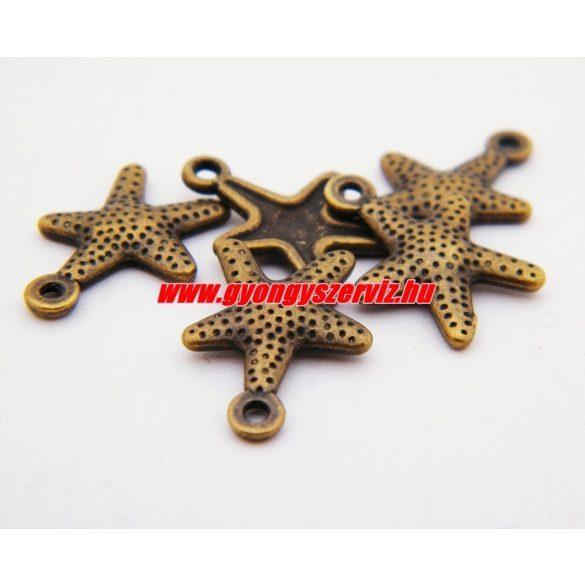 Fém medál, fityegő. Tengeri csillag. 17x12mm. Antik bronz szín. 10db.
