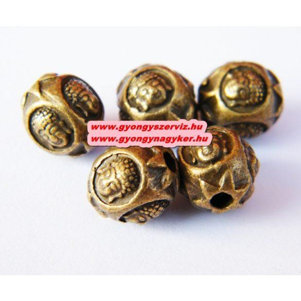 Fém köztes gyöngy, buddha fej gyöngy. 9.5x9mm. Antik bronz szín. 10db.