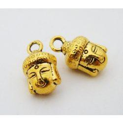 Fém medál, buddha fej. 9x14mm. Antik arany szín. 10db.
