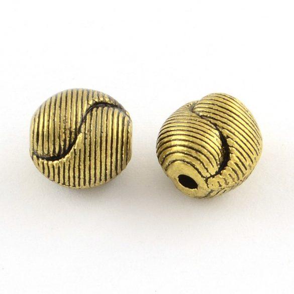 Golyó. 9.5x9.5x8mm. Yin-yang. Antik arany szín. Fémgyöngy, köztes gyöngy. 10db.