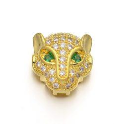 Cirkon leopárd fej gyöngy. Arany szín, zöld szem.