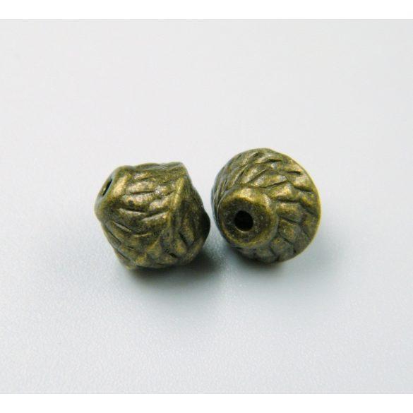 Bicone. Fém köztes gyöngy. 7x7mm. Antik bronz szín. 10db.