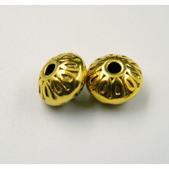 Diszkosz. Fém köztes gyöngy. 10x7mm. Antik arany szín. 10db.