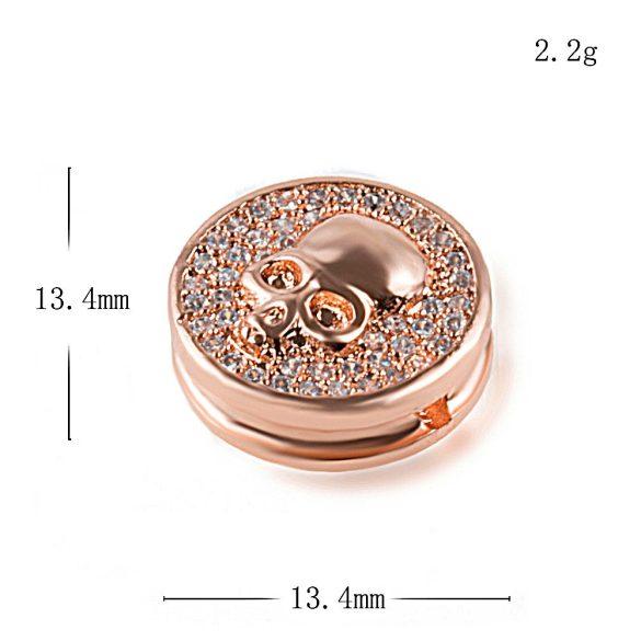 Cirkon kristályos, koponya köztes korong. Rózsaarany szín. 13.4x5.5mm.