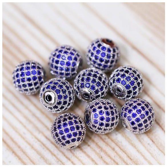 Cirkon köztes gyöngy. 10mm. Platina szín, kék kristály.