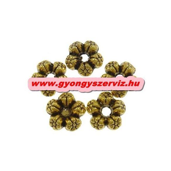 Virág. 8x4mm. Antik arany szín. Fémgyöngy, köztes gyöngy. 10db/csomag.