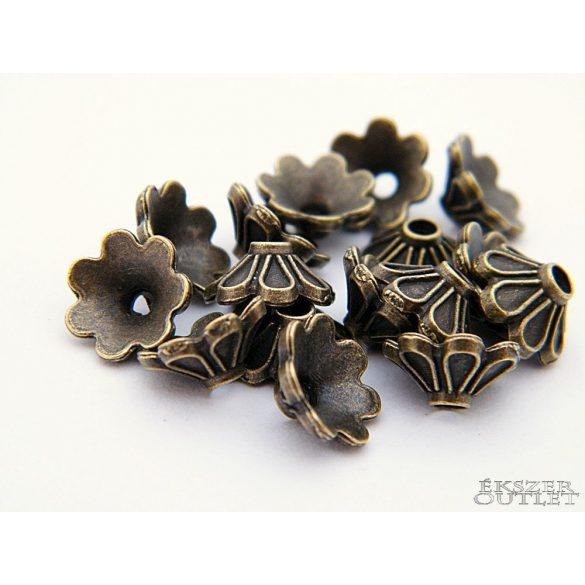 Gyöngykupak. Fém gyöngy. Virág.  9 x 4 mm. Antik bronz.    100db.