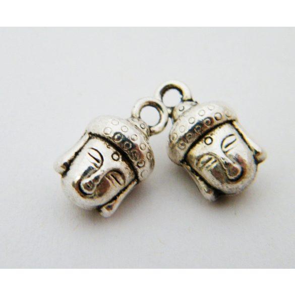 Fém medál, buddha fej. 9x14mm. Antik ezüst szín. 10db.